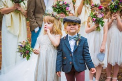 The little joyful children standing together outdoors