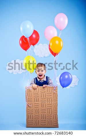 The Little Prince. Cute boy flying on a balloon
