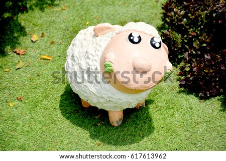 The little sheep statue decorate the garden, decorate it, add a nice atmosphere and beautiful. #617613962
