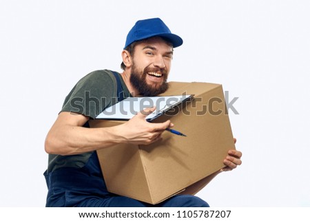 the loader carries a heavy box and documents in the hands                        #1105787207