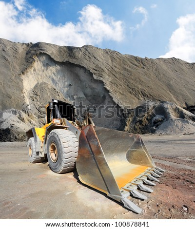 The loader excavator in a mine.