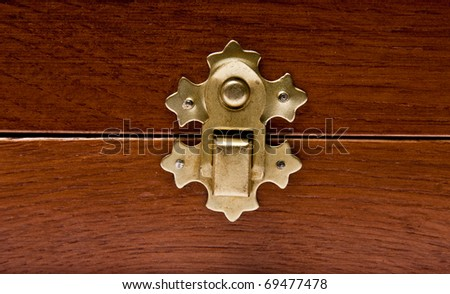 The lock of a wooden casket close up - stock photo