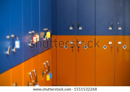 the locker room is empty with bright lockers #1551532268