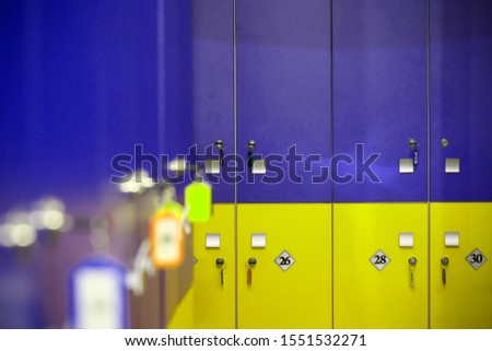 the locker room is empty with bright lockers #1551532271