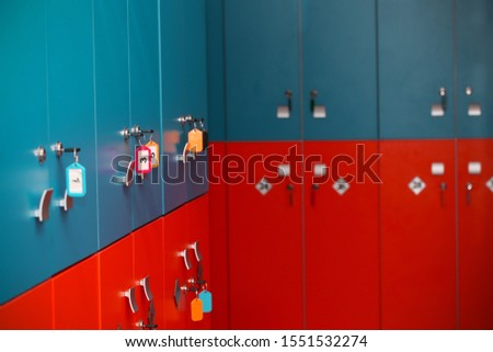 the locker room is empty with bright lockers #1551532274