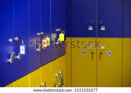 the locker room is empty with bright lockers #1551532277