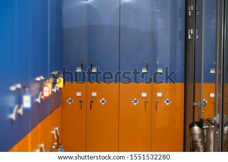 the locker room is empty with bright lockers #1551532280
