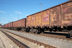 The locomotive drags freight cars