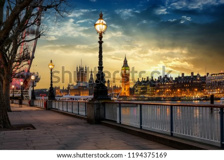 The London riverside of the Thames with view to the Big Ben clocktower and Westminster Palace during sunset, United Kingdom