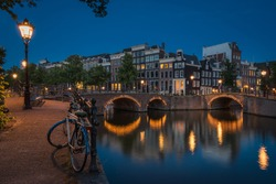 The lonely bike beside the canals at night, Amsterdam, the Netherlands