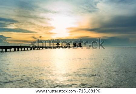 The long bridge over the sea with a beautiful sunrise, Thailand #715188190