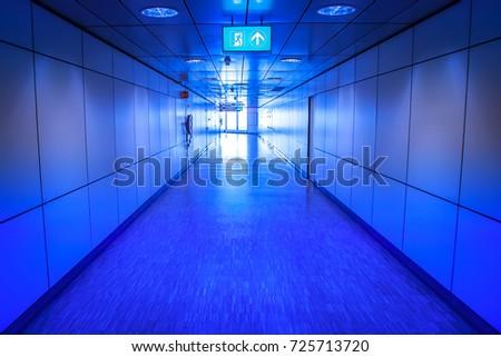 The long corridor. The blue corridor. signboard going out. #725713720