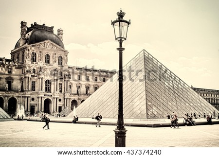 the louvre in paris on a sunny...