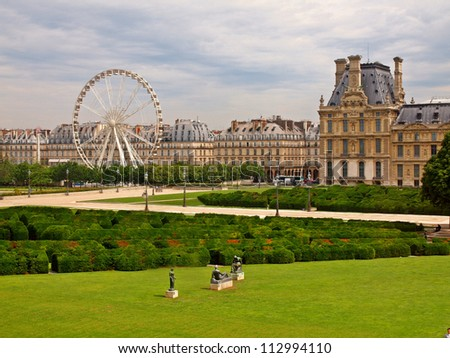 The Louvre Museum and the labyrinth in Paris city. - stock photo