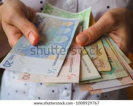 The love of money. Hands holding Euro banknotes.