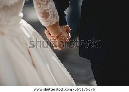 The lovely couple in love hold of hands #563175676