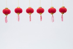 The lovely traditional  small red lanterns pattern line up Chinese New Year celebration hanging on white background, pattern of red lantern blessing fortune lunar, ornament with copy space