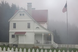 The low fog paints a gloomy but beautiful landscape around the lighthouse keeper's house/House in fog