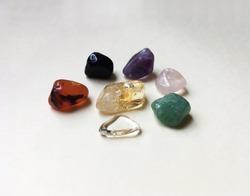 The 7 Lucky Stones:crystal-peace; agate-friendship;onyx-protection;pink quartz-love;green quartz-health;citrine-prosperity;amethyst-spirituality.
