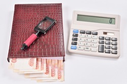 The lucrative business partners: money, calculator, calendar, magnifier