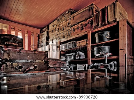 The luggage room of an old train station.