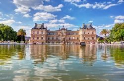 The Luxembourg Palace in The Jardin du Luxembourg or Luxembourg Gardens in Paris, France. View on the main facade and water pond