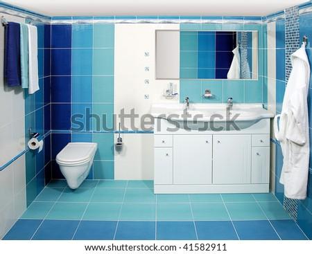 The luxury bathroom in blue with the bathrobe - stock photo