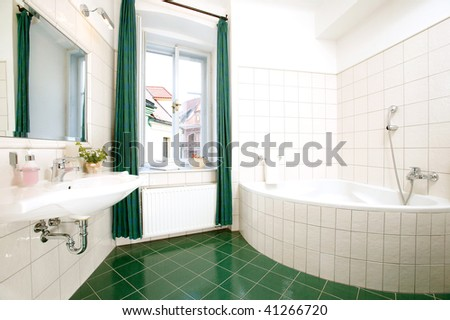 The luxury bathroom with the green curtain