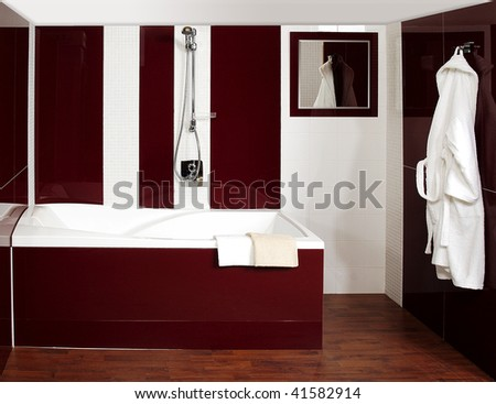 Bathroom on The Luxury Bathroom With The Mosaic And Dark Red Tiles Stock Photo