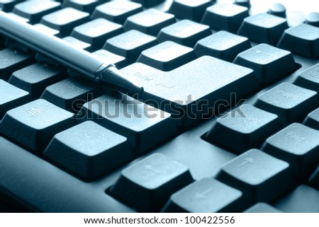 the luxury black pen on computer keyboard