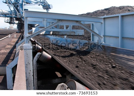 The machine belt is transporting and moving the mass of lignite to the tower plant t for produces the electricity