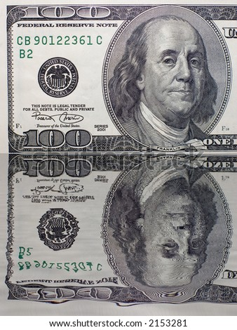 The macro of 100 dollars banknote with reflection