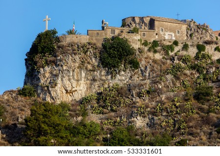 The Madonna della Rocca church, originated in the 12th century, restored in 1600, stands on a small mountain overlooking the town of Taormina in Sicily, Italy #533331601