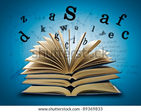 The Magic Book and the letters on a dark background with formula. Education concept