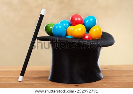 The magic of easter - colorful eggs in magician hats on golden background- shallow depth of field