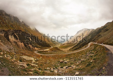 The magnificent mountain valley. Winding and dangerous road - the Serpentine. Photo taken by lens Fisheye