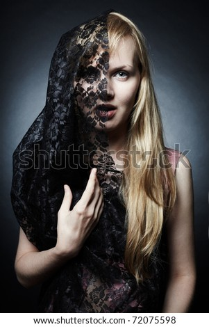 The magnificent mysterious young woman under a veil