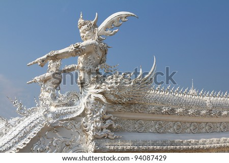 The magnificent sample of modern Thai architecture. An element of an ornament of a snow-white roof of a palace in the form of a flying demon