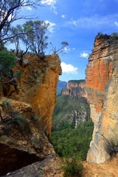 The magnificent sandstone vertical cliffs at Hanging Rock and Burramoko Head, Blue Mountains, NSW Australia.  Please note, this is NOT the Hanging Rock in Victoria.