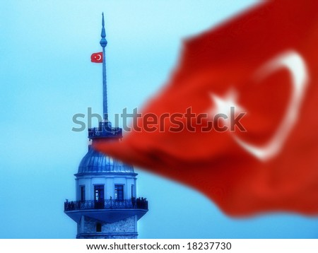the maiden's tower and turkish flag in istanbul, Turkey