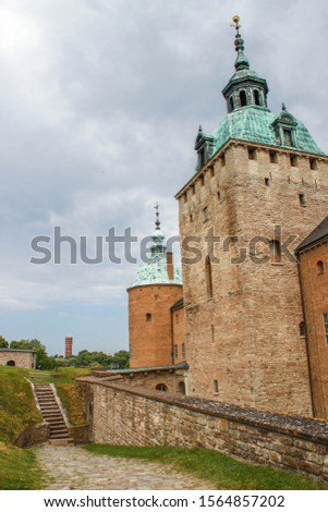 The main attraction of the city is the medieval stone Kalmar Fortress with tourists. In the province of Smaland in Sweden. one of Sweden's best preserved renaissance castles #1564857202