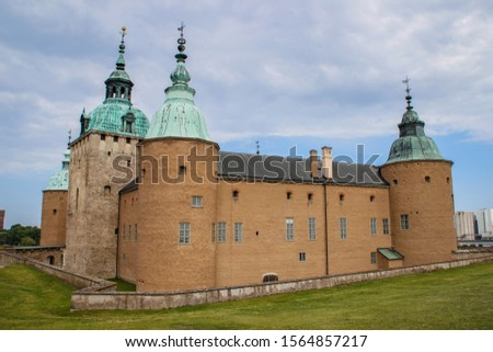 The main attraction of the city is the medieval stone Kalmar Fortress with tourists. In the province of Smaland in Sweden. one of Sweden's best preserved renaissance castles #1564857217