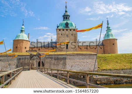 The main attraction of the city is the medieval stone Kalmar Fortress with tourists. In the province of Smaland in Sweden. one of Sweden's best preserved renaissance castles #1564857220