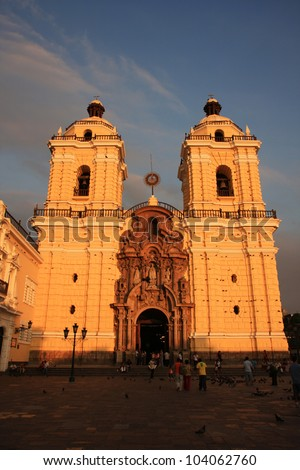 The main Cathedral in Lima, Peru, built in 1540, at dusk with golden light and shadows