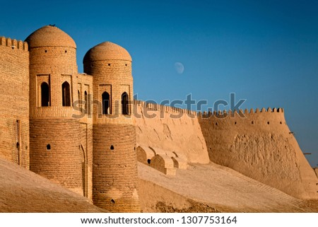 The main entrance gate to the city. Watchtowers and protective stone city wall. Khiva City, Central Asia, Uzbekistan.
