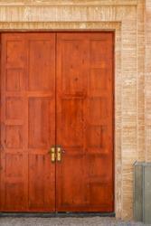 The main entrance of the European-style church, antique dark brown wooden door