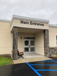 The main entrance to a generic looking building. Could be used as the entrance to a school, bank, hospital, etc.