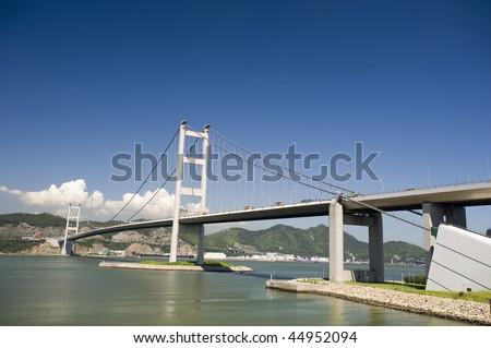 stock-photo-the-main-gateway-to-hong-kong-airport-tsing-ma-bridge-44952094.jpg