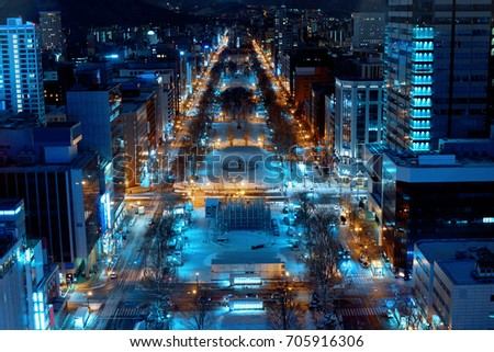Shutterstock The main street & landmark park of Sapporo city are decorated by illumination in winter from observation deck of TV tower, Hokkaido, Japan
