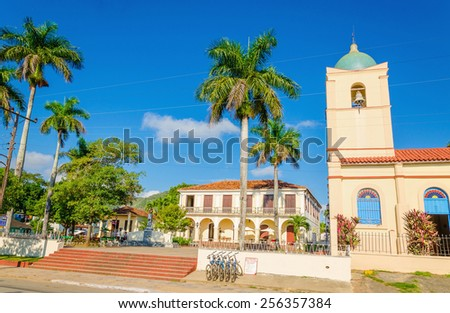 The main street of the Cuban town with a beautiful church in the background, Vinales, Cuba stock photo
